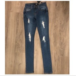 FashionNova NWOT distressed butt lifting jeans
